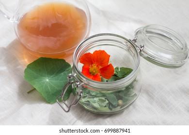 closeup of jar with nasturtium leaves and flower