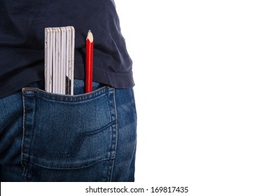 Closeup to jeans with ruler and pencil on white