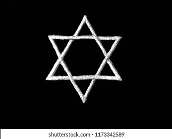 closeup of the Jewish badge star of David in the hand. The concept of the memory of the genocide of the Jews by the Nazis during the second world war. The day of memory of victims of the Holocaust