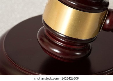Close-up of a judge gavel or auction hammer