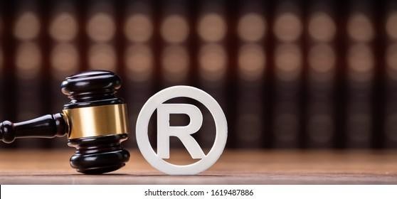 Close-up Of Judge Mallet Near Trademark Copyright Symbol