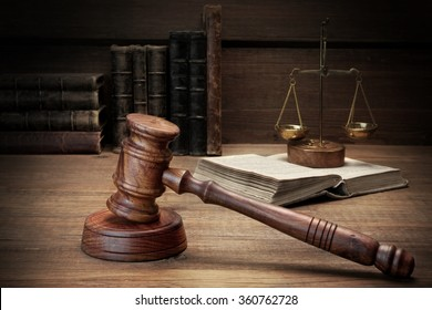 Closeup Of Judges Or Auctioneer Gavel, Legal Code, Scales Of Justice On The Rough Wooden Background. Law Concept