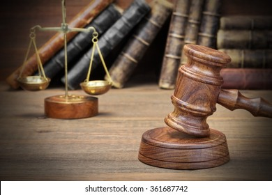 Closeup Of Judges Gavel, Legal Code, Scales Of Justice On The Rough Wooden Background. Law Concept