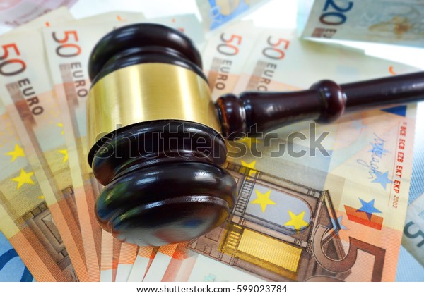 Closeup of judge's gavel on Euro notes