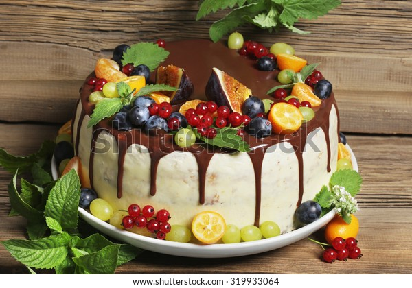 close-up of juicy fruit cake Rustic Style on  background of an old tree studio