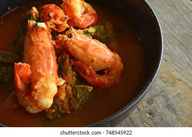 Close-Up of Kaeng-Som Cha-Om Kung is Thai Food. Thai sour soup made of tamarind and Fish paste and Chili Paste Acacia fry with Egg Boil and Shrimps or Prawn  Spicy Taste