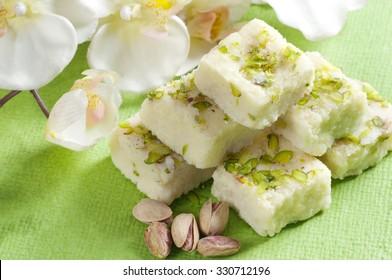 Close-up of kalakand and pistachio