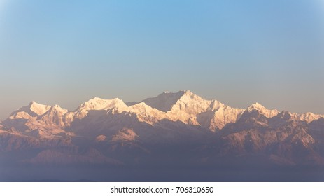 Close-up Kangchenjunga mountain in the morning with blue and orange sky that view from The Tiger Hill in winter at Tiger Hill, Darjeeling. India.