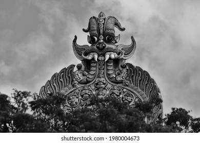 Close-up of the keertimukha figure on the northern gopuram (gate tower) of the 2,000 year-old Meenakshi Amman temple in Madurai, India