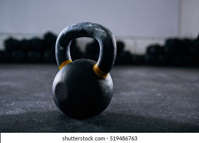 Close-up of kettlebell weight on gym floor