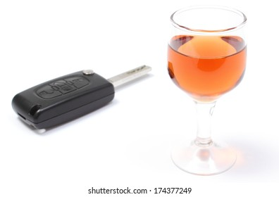 Closeup of key car with glass of wine, key car and alcohol, don't drink and drive concept. Isolated on white background