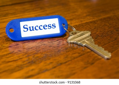 """Closeup of a key with the word """"success"""" on the label"""