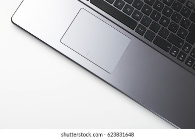 Close-up of keyboard of a laptop computer on white background.