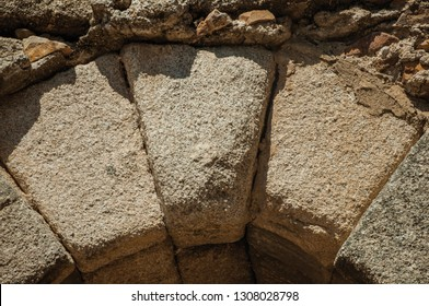 Close-up of keystone (or capstone), the wedge-shaped stone piece at the apex of a masonry arch at Merida. Founded by ancient Rome in western Spain, the city preserves many buildings of that era.