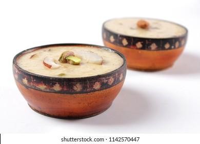 Closeup of Kheer, Traditional indian sweet dish, Pakistani dessert, Ramadan iftar meal, Ramzan dinner, Eid milan party, Diwali lunch, Side shot of christmas yummy treat.