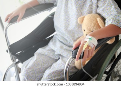 closeup of a kid on wheelchairs