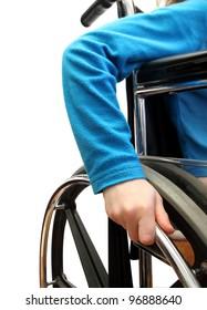 closeup of a kid in a wheelchair