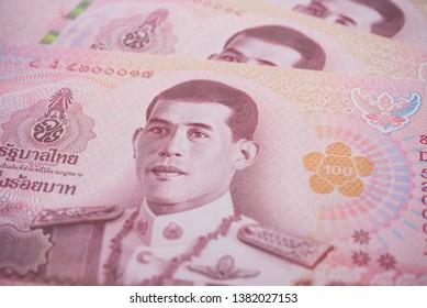 Closeup King Maha Vajiralongkorn Bodindradebayavarangkun (Rama 10) on 100 baht Thai banknotes bill texture background. Concept of Thai baht payment currency of Thailand, Forex investment, stock market