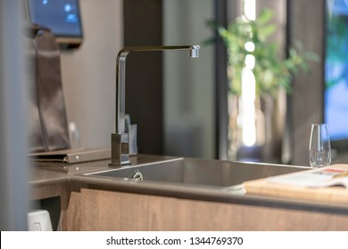 a closeup of a kitchen faucets