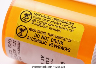 Close-up of a label on a bottle of prescription medication warning not to consume alcohol while using the drug