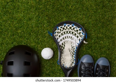 Close-Up Of Lacrosse Equipment On Green Grass Background. Team sport concept.