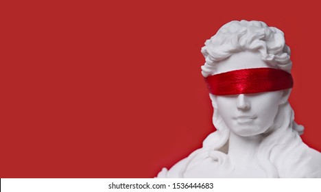 Close-up of lady justice with red blindfold. Panoramic image with copy space.