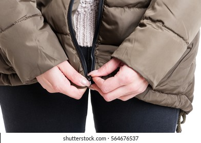 Close-up of lady zipping winter jacket isolated on white background