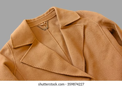 Close-up of lapel of wool coat on gray background.