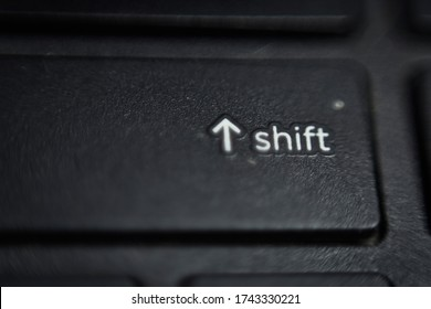 closeup of a laptop shift key with shallow depth of field, shift key