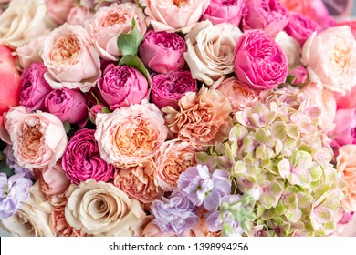Close-up Large Beautiful bouquet of mixed flowers. Flower background and Wallpaper. Floral shop concept . Beautiful fresh cut bouquet. Flowers delivery