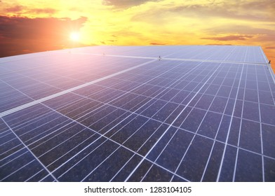 Close-up of a large solar panel against night sky with sunset