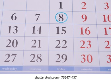 Closeup in a large weekly printed date and the eighth digit circled