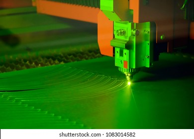 Close-up of the laser cutting machine cutting the stainless plate.