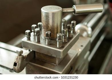 Closeup of lathe machine tool post on cross slide