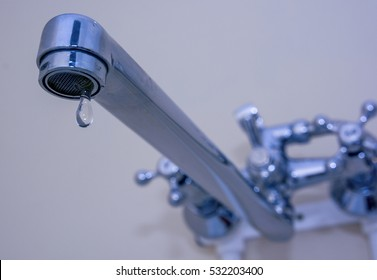 Closeup of leakage tap with dripping water