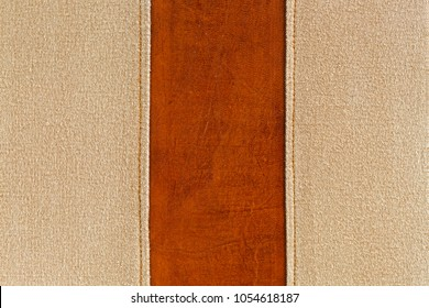 Closeup of leather background with fabric texture in natural brown and yellow shade of stitch