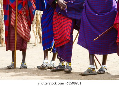 Closeup of legs and colorful textile of Masai tribe in Tanzania
