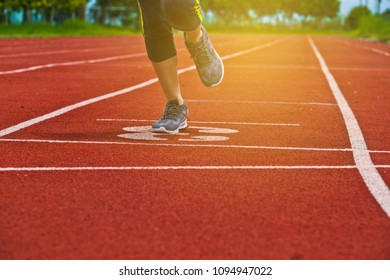 Closeup of legs of a track runner