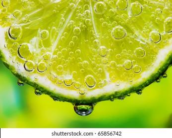 Close-up of a lemon slice with bubbles