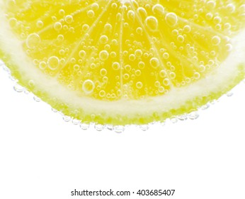 Close-up lemon in sparkling water white background