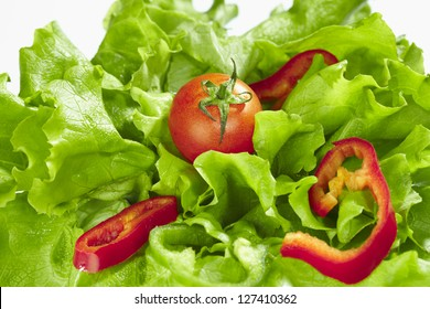 closeup to lettuce salad with tomato and pepper