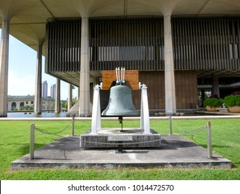 Close-up of Liberty Bell in front of the Hawaii State Capitol. Replica was made in 1950.