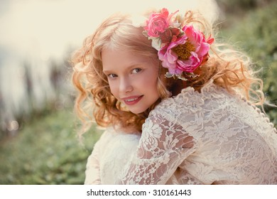 Closeup lifestyle portrait little bridesmaid  with bouquets  Beautiful Teenage Girl Having Fun in Autumn Park  with bunch of flowers wedding concept  cute princess girl Happy little schoolgirl