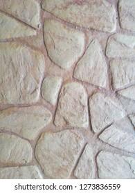 Closeup of light brown flagstone texture background.