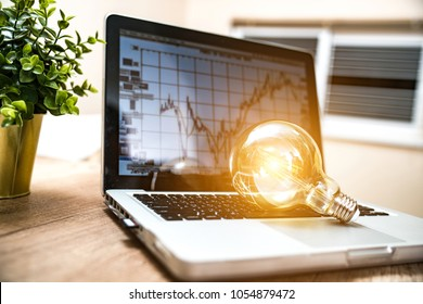 Closeup light bulb on keyboard laptop, New ideas, innovation, inspiration and creativity concept.