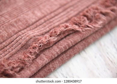 Closeup of light coral red fabric texture