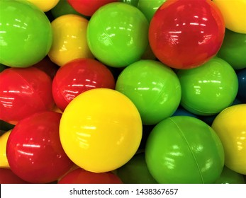 Close-up of light glossy plastic balls for children's dry pool in red, green, yellow and blue colors