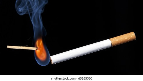 Closeup lighting cigarette. Isolated on black. Stop smoking collection.