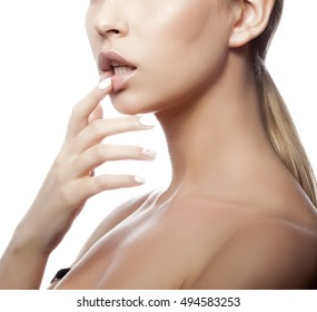 Close-up lips and shoulders of young caucasian girl with natural make-up, perfect skin and green eyes touching her lips isolated on white background. Studio portrait.