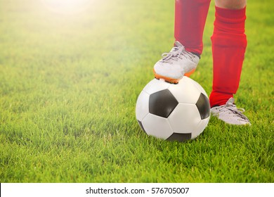 Close-up of little boy leg playing football on football pitch.Soccer,football Training on a football field.